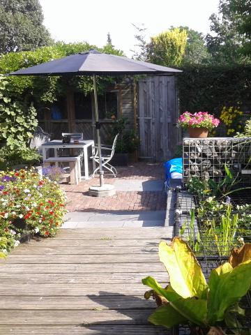 Foto van de tuin in B&B De Verwennerij